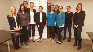 Dana Decent standing with Intact employees after her presentation