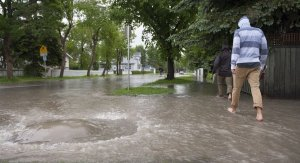 Man Walking in Flooded Neighbourhood