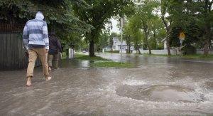 Man Walking in Flooded Neighbourhood