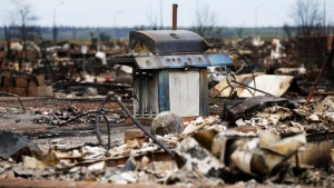 a bbq in the middle of a disaster area with other debris
