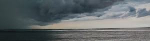 Dark clouds hovering of the sea