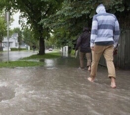 Flooded Neighbourhood with Man Walking