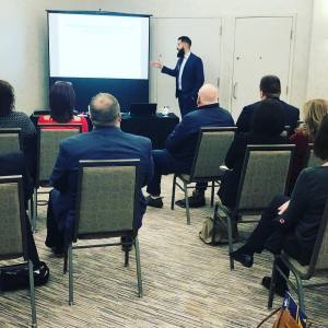 Daniel presenting at Atlantic Brokers event