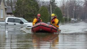 two people in raft floating in flooded street