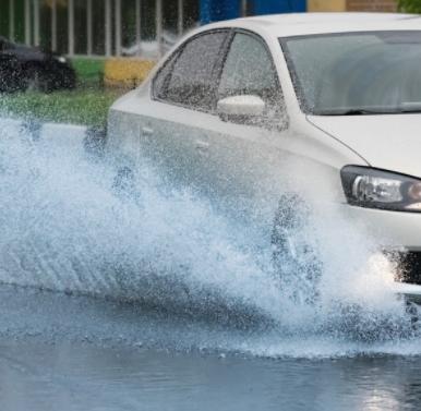 Car Driving through flood